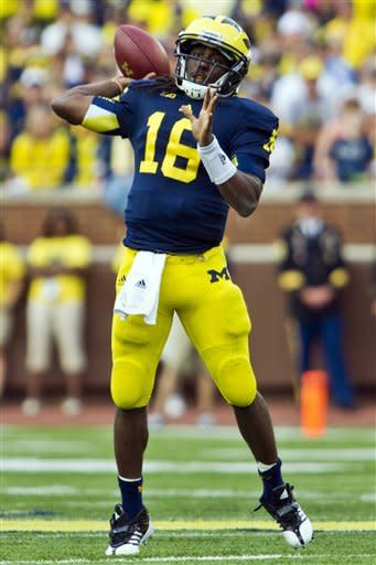 Michigan quarterback Denard Robinson (16) throws a pass in the third quarter of an NCAA college football game against Air Force, Saturday, Sept. 8, 2012, in Ann Arbor, Mich. Michigan won 31-25. (AP Photo/Tony Ding)