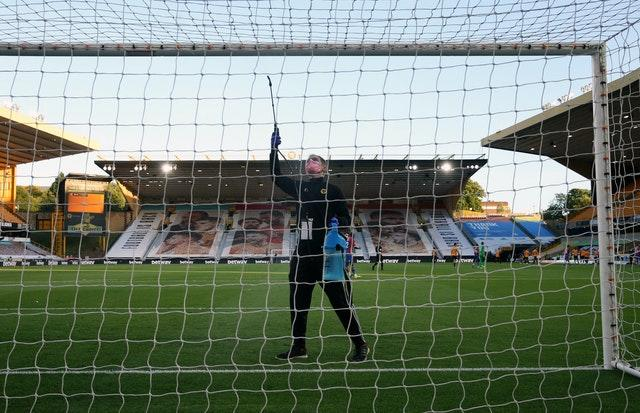A steward disinfects the crossbar at Molineux ahead of Wolves' clash with Crystal Palace. The task became a regular occurrence at grounds across the country in the wake of the coronavirus pandemic which prompted play to be suspended for more than three months