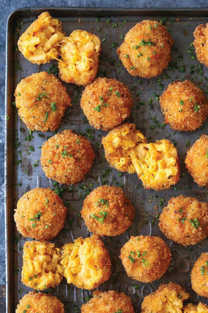 """<p>You could settle for mac and cheese (ok, that's not <em>really </em>settling), or you could treat yourself to poppable friend portions of the crowd favorite. </p><p><a href=""""https://damndelicious.net/2016/11/27/fried-mac-cheese-balls/?crlt.pid=camp.HZhcCrKQRouQ"""" rel=""""nofollow noopener"""" target=""""_blank"""" data-ylk=""""slk:Get the recipe."""" class=""""link rapid-noclick-resp"""">Get the recipe. </a></p>"""