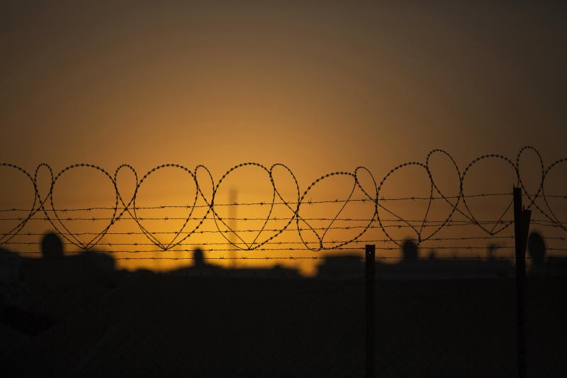 In this Thursday, Oct. 24, 2013, photo, the sun rises behind razor and barbed wire at the edge of Zaatari Refugee camp, near the Syrian border in Jordan. With Syria's civil war in its third year, more than 2 million Syrians have fled their country. About 100,000 live in this camp. (AP Photo/Manu Brabo)