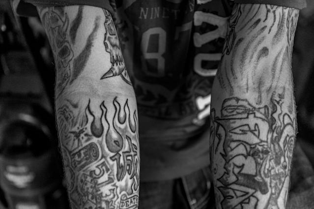 <p>Larry Fugate is a recovering heroin addict at home in Middletown, Ohio. Five months ago, his mom Terri Fugate resuscitated him after a heroin overdose. He drew most of his tattoos himself. (Photograph by Mary F. Calvert for Yahoo News) </p>