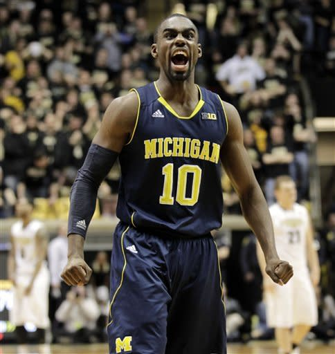 Michigan guard Tim Hardaway Jr. (10) reacts to a teammate being fouled late in the second half of an NCAA college basketball game against Purdue, Wednesday, March 6, 2013 in West Lafayette, Ind. Michigan won 80-75. (AP Photo/AJ Mast)