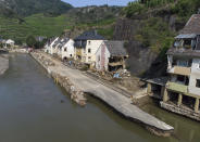 The village street in Mayschoß is swept away by the flood wave, Germany, July 20, 2021. Numerous houses in the village were completely destroyed or severely damaged. (Boris Roessler/dpa via AP)