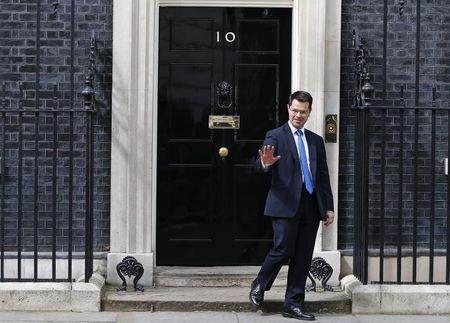 Britain's new Northern Ireland Secretary James Brokenshire leaves Number 10 Downing Street in London
