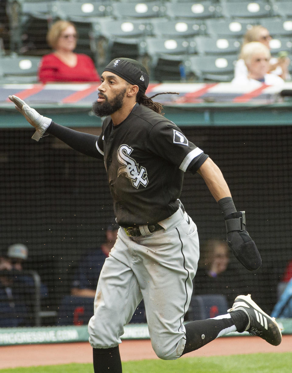 Chicago White Sox's Billy Hamilton celebrates after scoring on a steal against the Cleveland Indians during the eighth inning inning of a baseball game in Cleveland, Sunday, Sept. 26, 2021. (AP Photo/Phil Long)
