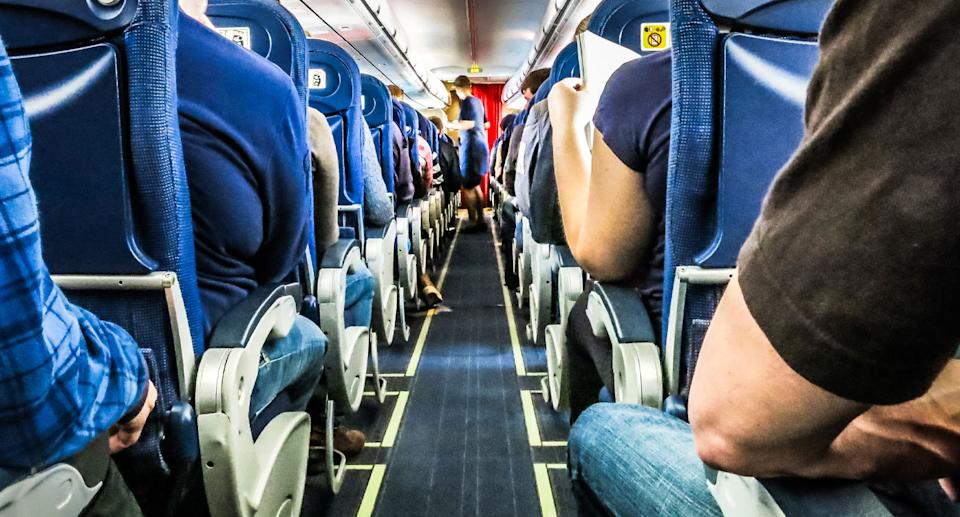 Photo of plane aisle. People with a fear of flying shan't worry, according to a Queensland aviation expert.