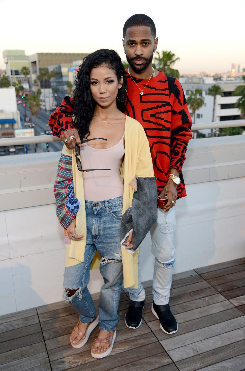 """<p>""""Once again, Jhene stands in front of Big Sean,"""" Donaldson points out. By standing behind Jhené, he's communicating that he's prepared to have her back whenever she needs him to. And his arm around her shoulder (spoiler: body language you'll see from him more than a few times) is how he shows his love. It's a reminder to Jhené that he's there for her no matter what.</p>"""