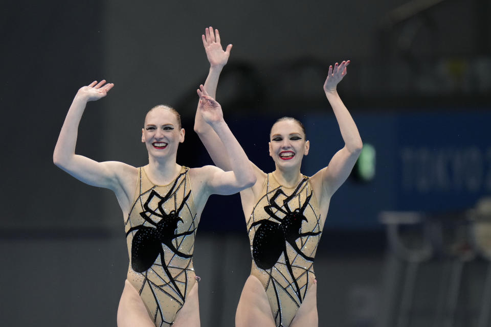 Svetlana Kolesnichenko and Svetlana Romashina of Russian Olympic Committee celebrate after competing in the duet free routine final at the the 2020 Summer Olympics, Wednesday, Aug. 4, 2021, in Tokyo, Japan. (AP Photo/Alessandra Tarantino)