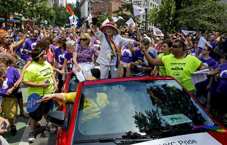 Grand Marshall Edith Windsor, the 84-year-old woman at the center of the U.S. Supreme Court decision granting gay couples federal marriage benefits, is surrounded by well wishers during the gay pride march in New York Sunday, June 30, 2013. Same-sex marriage supporters gathering for gay pride parades in several major U.S. cities got more good news Sunday when Supreme Court Justice Anthony Kennedy denied a last-ditch request from the sponsors of California's now-overturned gay marriage ban to halt the issuance of same-sex marriage licenses in the nation's most populous state. (AP Photo/Craig Ruttle)