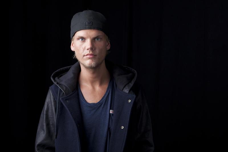 FILE - In this Aug. 30, 2013 file photo, Swedish DJ, remixer and record producer Avicii poses for a portrait, in New York. TomorrowWorld organizers are taking extra precaution to maintain a safe environment for concertgoers this weekend after two drug-related deaths occurred at a similar festival in New York earlier this summer. Top EDM acts from Avicii, David Guetta to Diplo are among 300 internationally renowned DJs and performers that will take to eight different stages at the three-day festival that kicks-off in South Fulton County in suburban Atlanta on Friday, Sept. 27, 2013. (Photo by Amy Sussman/Invision/AP, File)