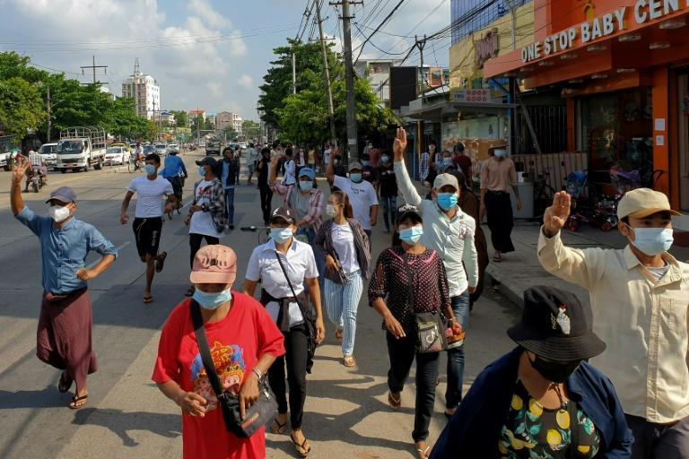 Protesters made the three-finger salute during a demonstration against the military coup in Yangon as Myanmar entered its fourth month under military rule