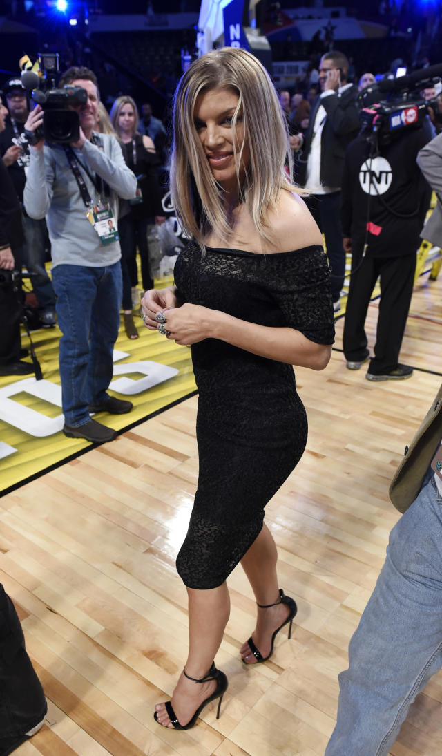 Singer Fergie walks off the court following the NBA All-Star Game on Sunday, Feb. 18, 2018, in Los Angeles. (AP Photo/Chris Pizzello)