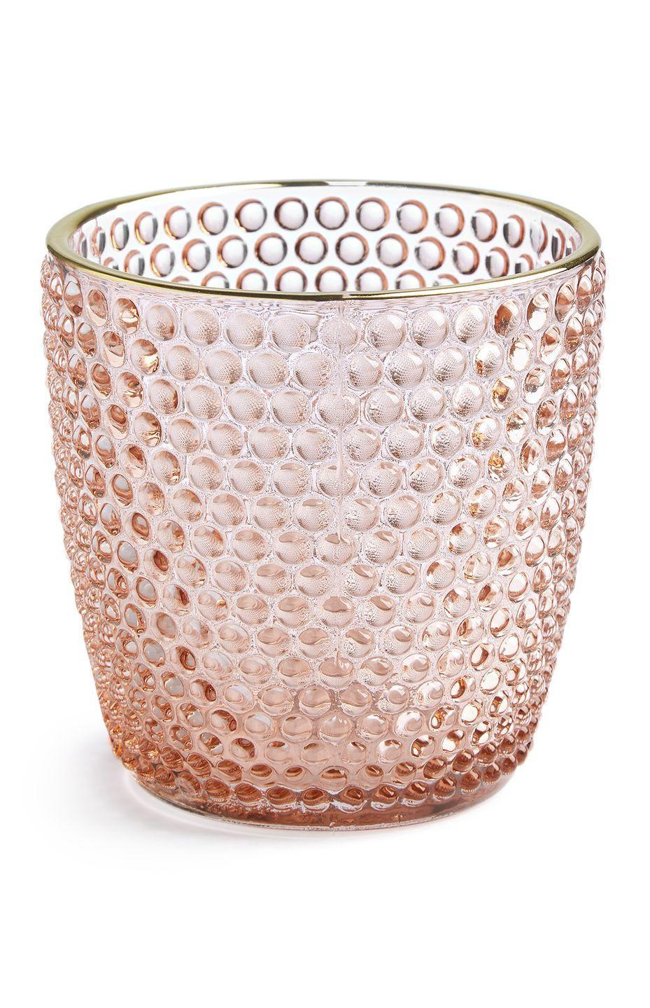 <p>Dimpled candle holder in pink, £2.00</p>