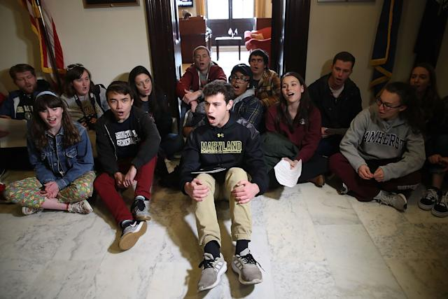 Students sit and protest in front of Senate Majority Leader Mitch McConnell's office in Washington, D.C., to urge Congress to change gun laws in the wake of the shooting in Parkland, Florida, last month.