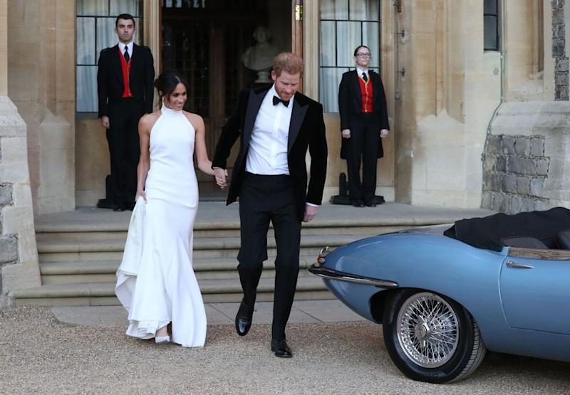 Meghan Markle and Prince Harry depart for their evening wedding reception at Frogmore House on May 19.