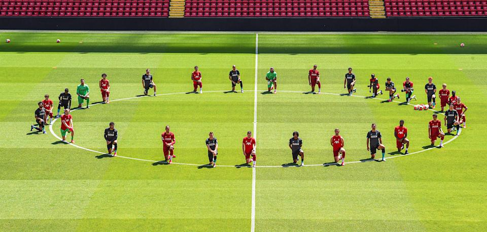 LIVERPOOL, ENGLAND - JUNE 01: (THE SUN OUT, THE SUN ON SUNDAY OUT) Liverpool players take a knee in memory of George Floyd at Anfield on June 01, 2020 in Liverpool, England. (Photo by Andrew Powell/Liverpool FC via Getty Images)