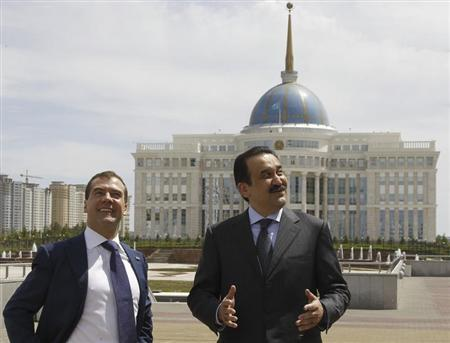 Karim Masimov talks with Dmitry Medvedev during their meeting in Astan