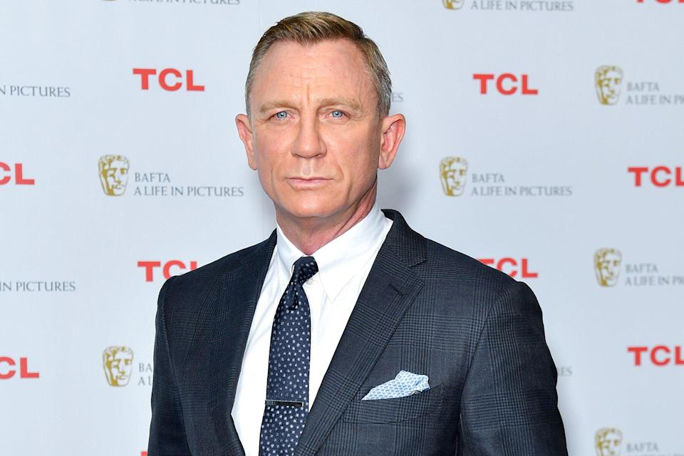 """Daniel Craig poses during the """"BAFTA: A Life in Pictures with Daniel Craig"""" supported by TCL mobile photocall at Odeon Luxe Leicester Square on September 24, 2021 in London, England."""