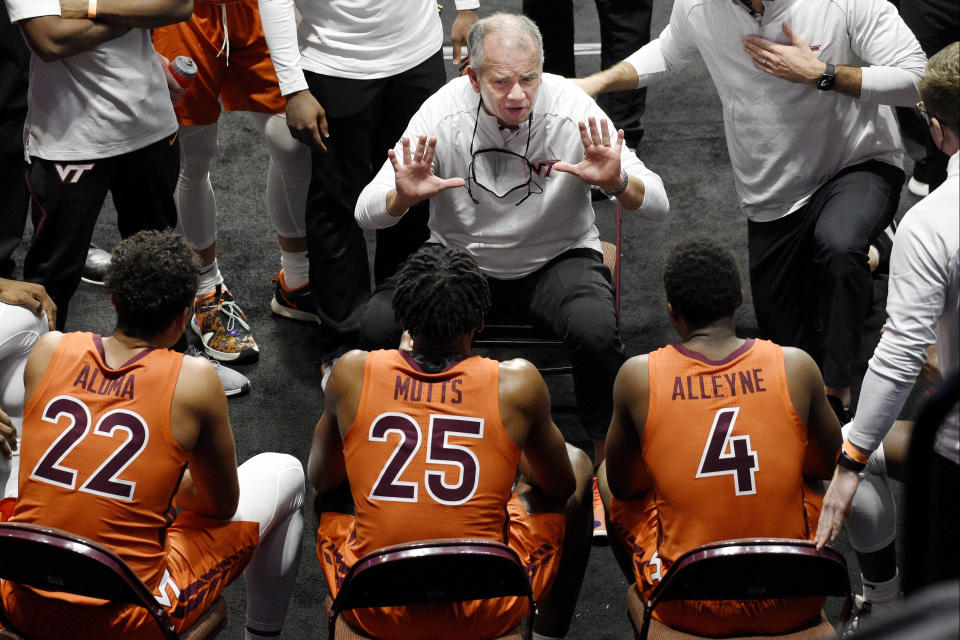 Virginia Tech's Mike Young, center top, talks to his team during a timeout in the first half of an NCAA college basketball game against Villanova, Saturday, Nov. 28, 2020, in Uncasville, Conn. (AP Photo/Jessica Hill)