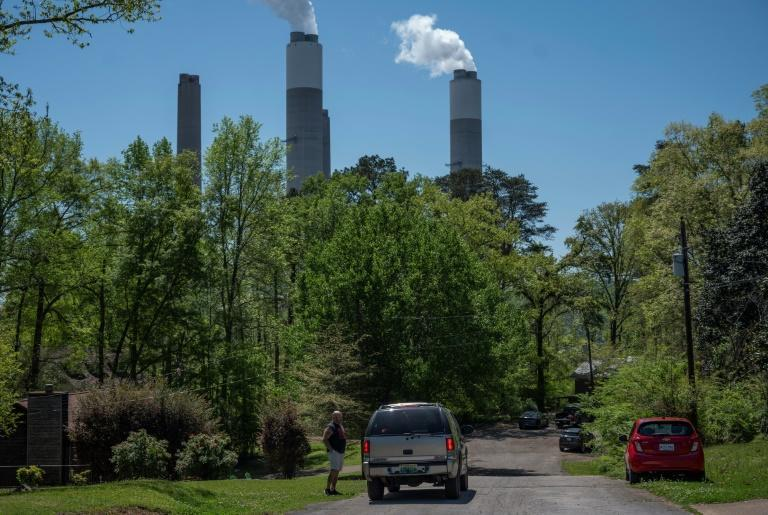 The smokestacks from the Miller power plant in Alabama tower over a residential neighborhood