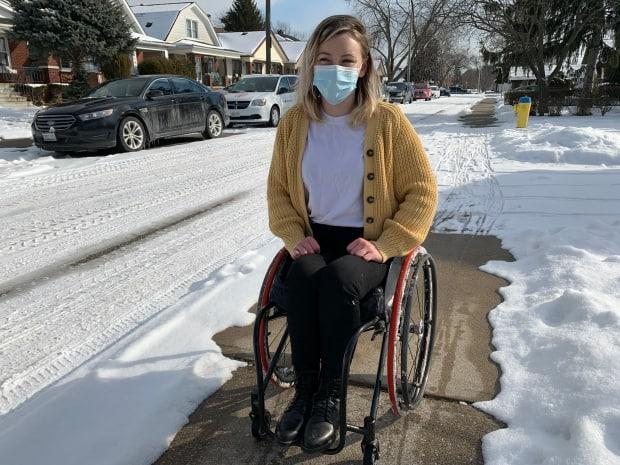 Danica McPhee says she initially gets angry when trying to get through a sidewalk with unshovelled snow.