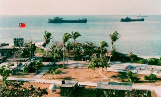 Two Taiwanese warships dock near the shore of Taiping Island
