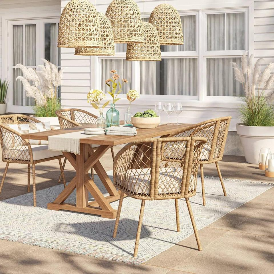<p>The <span>Morie Farmhouse Wood Rectangle Dining Table</span> ($450) features gorgeous crisscross legs and a V-frame trestle. </p>