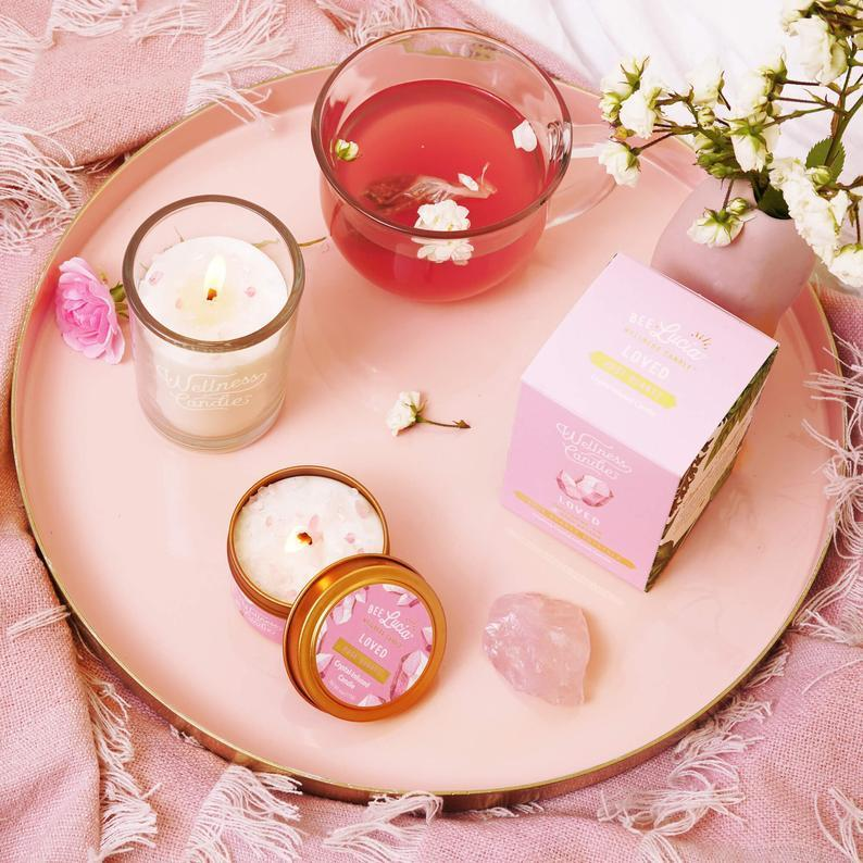 """<h3><strong><a href=""""https://www.etsy.com/listing/557429084/loved-wellness-candle-8oz-boxed-glass"""" rel=""""nofollow noopener"""" target=""""_blank"""" data-ylk=""""slk:Loved Wellness Candle"""" class=""""link rapid-noclick-resp"""">Loved Wellness Candle</a></strong></h3><br>This handcrafted wellness candle uses its infused blend of fresh mint, pure beeswax, organic coconut oil, therapeutic-grade pure essential oils, and natural rose-quartz crystals to cultivate positive, renewed, and compassionate vibes when lit. <br><br><strong>BeeLuciaWellness</strong> Loved Wellness Candle®, $, available at <a href=""""https://go.skimresources.com/?id=30283X879131&url=https%3A%2F%2Fwww.etsy.com%2Flisting%2F557429084%2Floved-wellness-candle-8oz-boxed-glass"""" rel=""""nofollow noopener"""" target=""""_blank"""" data-ylk=""""slk:Etsy"""" class=""""link rapid-noclick-resp"""">Etsy</a>"""