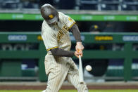 San Diego Padres' Wil Myers hits a single, driving in two runs, off Pittsburgh Pirates starting pitcher Luis Oviedo during the seventh inning of a baseball game in Pittsburgh, Monday, April 12, 2021. (AP Photo/Gene J. Puskar)