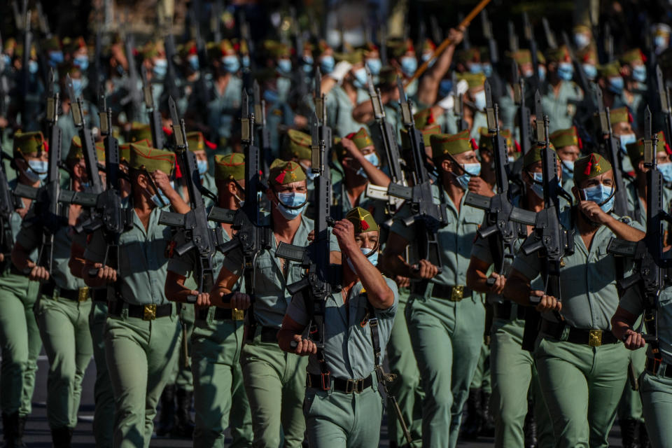 Members of La Legion, an elite unit of the Spanish Army, march during a military parade as they celebrate a holiday known as 'Dia de la Hispanidad' or Hispanic Day in Madrid, Spain, Tuesday, Oct. 12, 2021. Spain commemorates Christopher Columbus' arrival in the New World and also Spain's armed forces day. (AP Photo/Manu Fernandez)