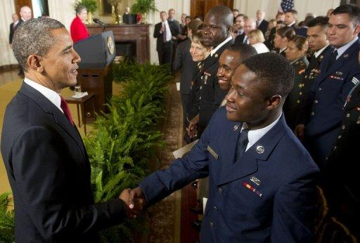 US President Barack Obama shakes hands with active duty US service members after they became US citizens. Obama held a naturalization ceremony for active duty members in the White House mid-morning and was expected to host a barbeque complete with a concert and fireworks later in the day