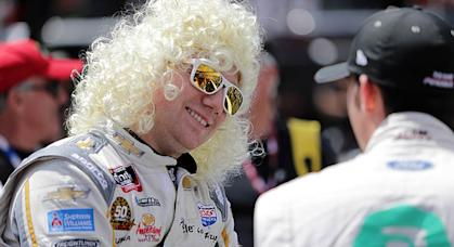 Tyler Reddick dons a Dolly Parton wig during pre-race ceremonies at Bristol Motor Speedway.