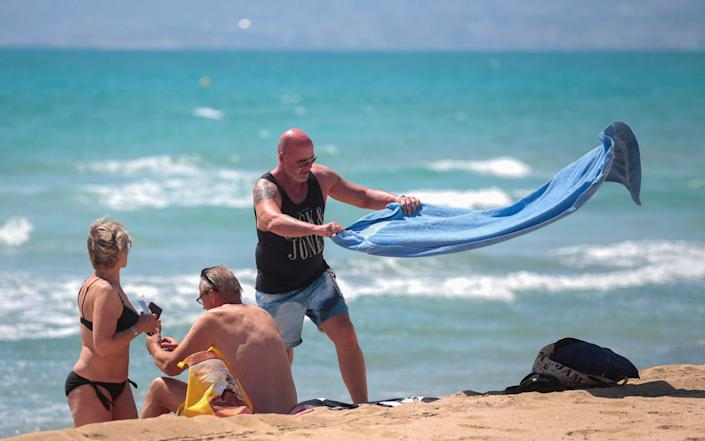 German tourists at a beach in Mallorca on Monday - AP