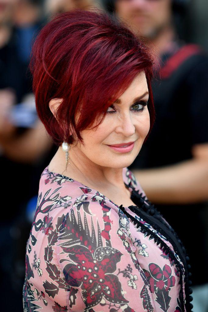 Sharon Osbourne is famous for her deep red locks, pictured here at X Factor auditions in 2017 (Getty)