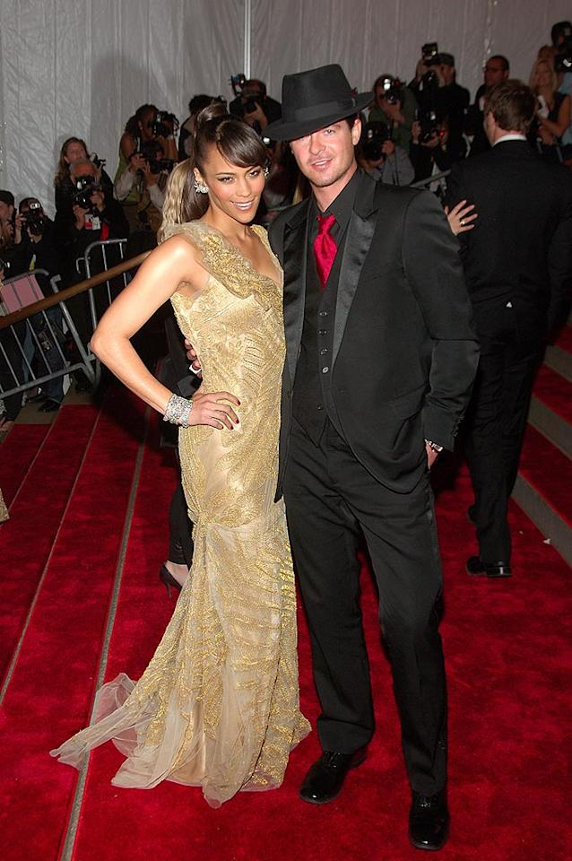 """Who doesn't love a man in a hat? A dapper Robin Thicke showed off his gorgeous wife Paula Patton. Michael Loccisano/<a href=""""http://www.filmmagic.com/"""" target=""""new"""">FilmMagic.com</a> - May 5, 2008"""