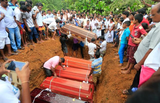 <p>Sri Lankan villagers prepare to bury victims of a landslide at a cemetery in Bellana village, in Kalutara district in, Sri Lanka, Saturday, May 27, 2017. Sri Lanka has appealed for outside help as dozens were killed in floods and mudslides and dozens others went missing. (AP Photo/Eranga Jayawardena) </p>
