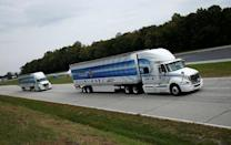 """Two trucks demonstrate """"platooning"""" technology at the Navistar Proving Grounds in New Carlisle, Indiana, U.S., October 12, 2016. REUTERS/Jim Young"""