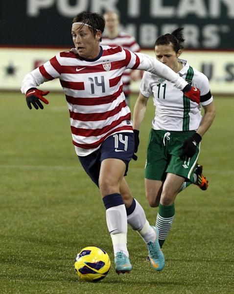 United States forward Abby Wambach, left, races with the ball ahead of Ireland midfielder Aine O'Gorman during the first half of their exhibition soccer match in Portland, Ore., Wednesday, Nov. 28, 2012. (AP Photo/Don Ryan)