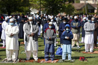 Muslims perform an Eid al-Fitr prayer in an outdoor open area, marking the end of the fasting month of Ramadan, Thursday, May 13, 2021 in Morton Grove, Ill. (AP Photo/Shafkat Anowar)