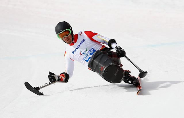 SOCHI, RUSSIA - MARCH 08: Josh Dueck of Canada competes in the Men's Downhill Sitting during day one of Sochi 2014 Paralympic Winter Games at Rosa Khutor Alpine Center on March 8, 2014 in Sochi, Russia. (Photo by Tom Pennington/Getty Images)