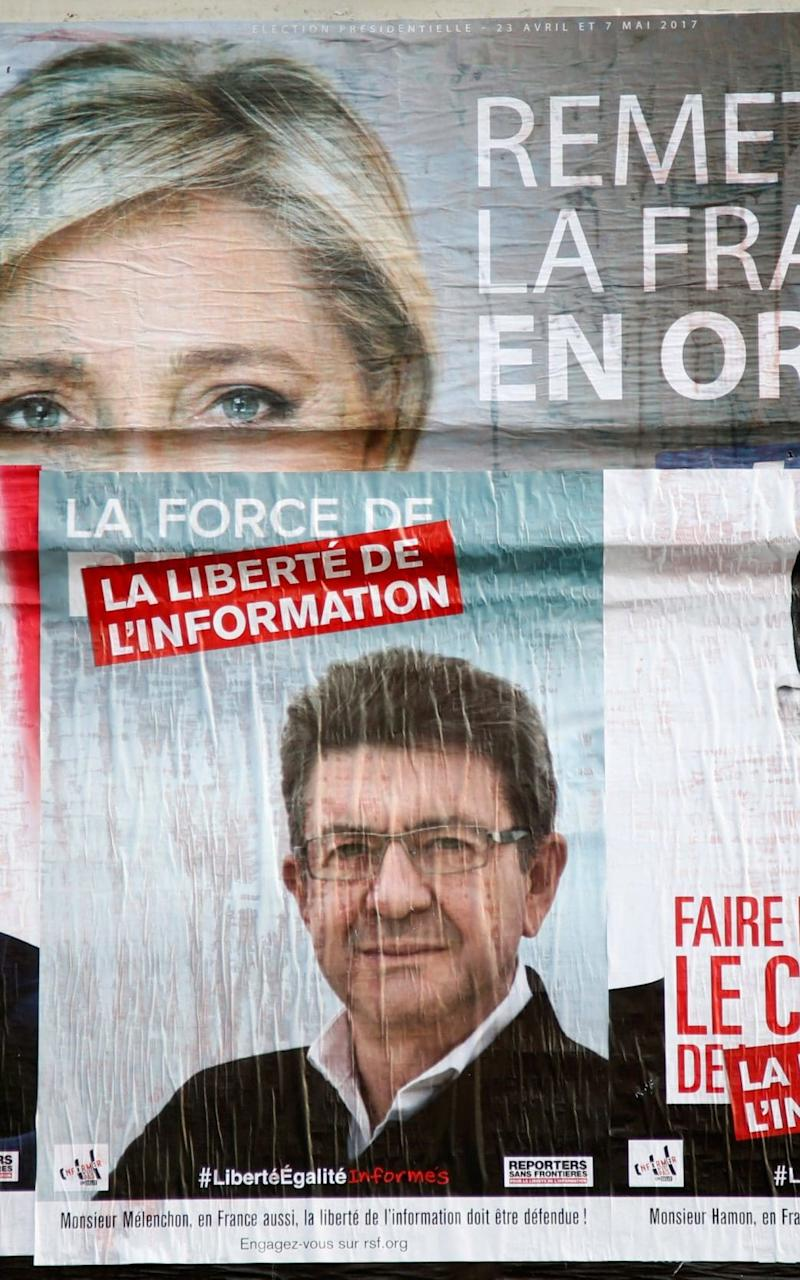 Campaign posters showing Jean-Luc Mélenchon and Marine Le Pen - Credit: CHARLES PLATIAU/Reuters