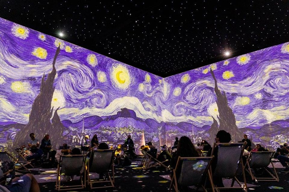 Visitors watch the immersive Van Gogh exhibition (Tristan Fewings/Getty Images/PA)