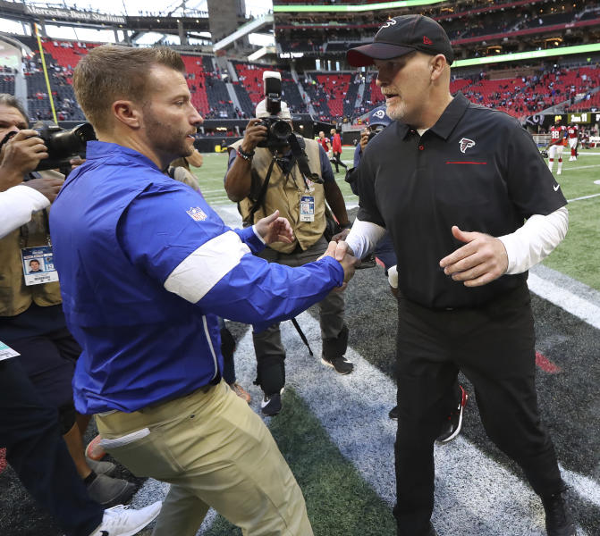 Atlanta Falcons head coach Dan Quinn, right, shakes hands with Los Angeles Rams head coach Sean McVay after an NFL football game Sunday, Oct. 20, 2019, in Atlanta. (Curtis Compton/Atlanta Journal-Constitution via AP)