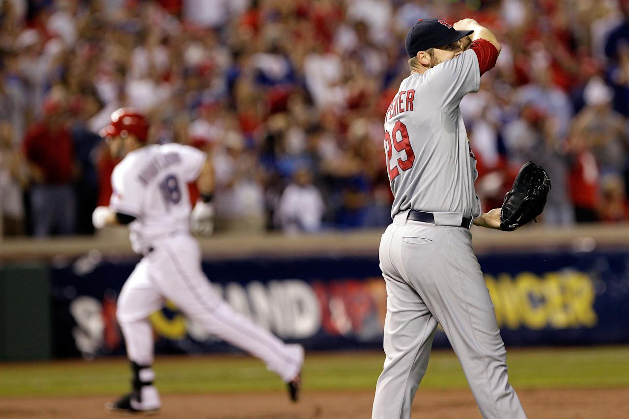 ARLINGTON, TX - OCTOBER 24: Chris Carpenter #29 of the St. Louis Cardinals reacts after giving up a solo home run to Mitch Moreland #18 of the Texas Rangers in the third inning during Game Five of the MLB World Series at Rangers Ballpark in Arlington on October 24, 2011 in Arlington, Texas.  (Photo by Rob Carr/Getty Images)
