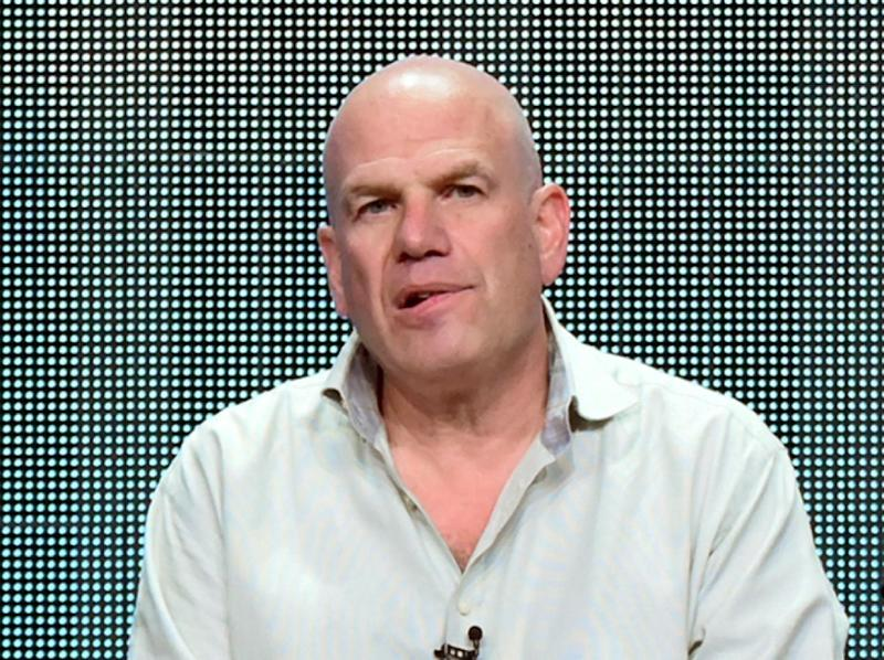 "FILE - In this July 30, 2015 file photo, producer David Simon appears during the ""Show Me a Hero"" panel at the HBO 2015 Summer TCA Tour in Beverly Hills, Calif. Simon and Fox News Channel host Sean Hannity are tossing vulgarities at each other on social media. Simon, who made ""The Wire,"" sent out a mocking tweet about Hannity hosting a Donald Trump town hall meeting about issues confronting black America. (Photo by Richard Shotwell/Invision/AP, File)"