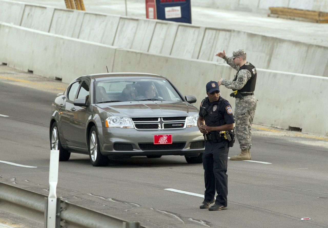 Vehicles are checked at the Bernie Beck Main Gate at Fort Hood, Texas, April 2, 2014. Several people were killed and at least 14 injured on Wednesday when a gunman opened fire at a U.S. Army base in Fort Hood, Texas, the site of another rampage in 2009, U.S. officials said. REUTERS/Austin American-Statesman/Deborah Cannon (UNITED STATES - Tags: CRIME LAW MILITARY) NO SALES. NO ARCHIVES. FOR EDITORIAL USE ONLY. NOT FOR SALE FOR MARKETING OR ADVERTISING CAMPAIGNS. MANDATORY CREDIT