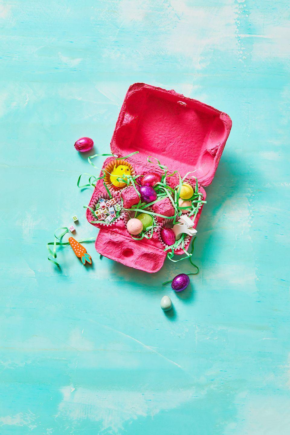 <p>Lean into the spirit of the season by painting an old egg carton with craft paint and filling with holiday treats. Add mini muffin liners and Easter grass inside each egg slot, so loose jelly beans and chocolate eggs stay put. </p>