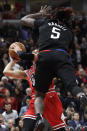Chicago Bulls guard Zach LaVine, left, shoots against Los Angeles Clippers forward/center Montrezl Harrell during the second half of an NBA basketball game Saturday, Dec. 14, 2019, in Chicago. The Bulls won 109-106. (AP Photo/Nam Y. Huh)