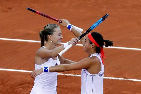Tennis - Fed Cup - World Group Semi-Final - France v Romania - Kindarena, Rouen, France - April 21, 2019 France's Kristina Mladenovic and Caroline Garcia celebrate after winning their doubles match against Romania's Simona Halep and Monica Niculescu REUTERS/Charles Platiau