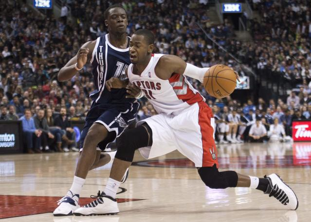 Toronto Raptors forward Terrence Ross, right, drives past Oklahoma Thunder guard Reggie Jackson during the first half of an NBA basketball game in Toronto on Friday, March 21, 2014. (AP Photo/The Canadian Press, Nathan Denette)